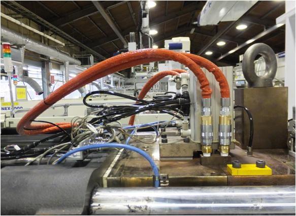 自動車の成形部品の製造現場における温調水の昇温時間短縮と火傷対策の事例